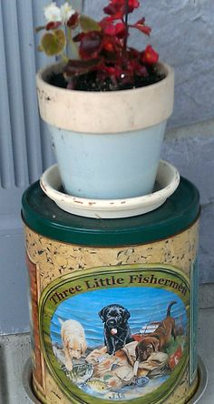 Use an old popcorn tin for a plant stand!