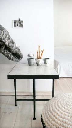 Contemporary style square Moroccan mosaic table, unique look both indoors and out.Tiles are carefully inlaid by hand on a concrete base and black iron frame. With folding legs Iron..: Mosaic Color: Pearl White.: Mosaic Design: Tile Squares.: Size: 40cm x 40cm // 15,8in x 15,8in.: Legs Size: 40cm // 15,8in.: Table frame: square Iron .: Folding Legs: Iron .: Metal Finish: Rustic blackAll of the Moroccan Mosaic Zellij is produced in the historic city...