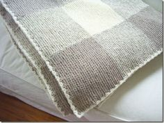 Gingham blanket - all in garter stitch. Knit 7 longs 'scarves' Tutorial shown - number of stitches etc Cozy things blog http://cozymadethings.blogspot.com/search?updated-max=2012-04-30T09:19:00-04:00=7=126=false