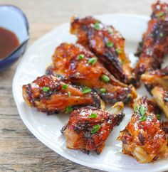 Crispy wings, baked with a spicy sweet sticky glaze, these are the perfect party wings. The sriracha sauce brings a lovely red hue to the wings. Sweet honey is added to the glaze to balance out the spice. Like most of my other oven baked wing recipes, the prep work for these is relatively stress-free. …