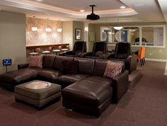 """Both traditional theater seating and comfortable lounge-style seats make sure everyone in the family is happy."" Full story: http://www.electronichouse.com/article/home_theater_bar_and_workout_space_all_in_one"