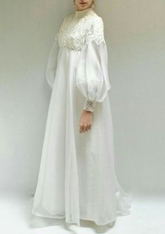 Love the simplicity of this bridal attire and the lace work. It would be ideal for your beach wedding! Abaya Fashion, Muslim Fashion, Fashion Dresses, Dress Brokat, Kebaya Dress, Muslim Wedding Dresses, Muslim Dress, Wedding Abaya, Wedding Hijab Styles