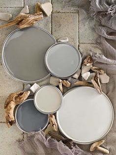 With tones as varied as driftwood gray and creamy latte, neutrals are anything but boring. Browse www.BHG.com's top neutral paint color picks to find the right hue for your rooms. Plus, learn the best tricks for decorating in neutrals.