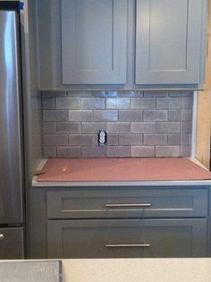"Pembroke, Georgia - Custom Ken Mason 3"" x 6"" Tile Backsplash being installed. Custom Aspect Cabinetry by Owens Supply Company."