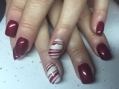 Acrylic nails with red and white gel polish. Candy cane.