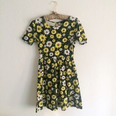 Floral patterned skater dress Skater dress featuring adorable white and yellow floral print on black background. Worn only a few times, so it's in great condition. 95% cotton and 5% spandex. Forever 21 Dresses