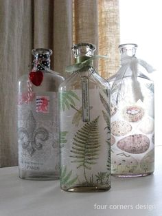 four corners design: Creative distraction  decoupaged napkins onto bottles