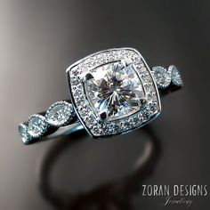 Custom engagement ring with cushion center,diamond halo and vintage inspired details