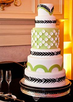 green, black, and white wedding cake