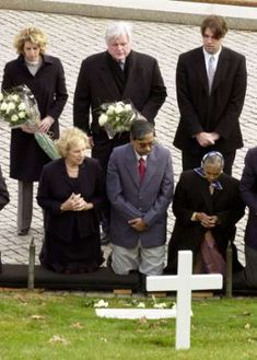 Members of the Kennedy family at the gravesite of Robert Kennedy buried in Section 45 at Arlington National Cemetery.