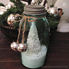 I'm finding myself gravitating towards very clean and simple Christmas decor this year. Love vintage mason jars filled with Epsom salt and bottle brush trees!
