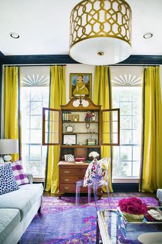 Gorgeous modern meets traditional furnishings in a living room bursting with color and pattern!