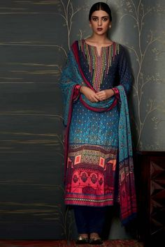 Blue Pashmina Trouser Suit Indian Casual Wear Dress Grey and Blue printed Pure Pashmina semi stitch trouser suit.V neck, Below knee length, full sleeves kameez. Blue pure pashmina trouser. Blue chiffon dupatta. Product are available in 34,36,38,40 sizes. It is perfect for Party Wear.  http://www.andaazfashion.co.uk/salwar-kameez/trouser-suits
