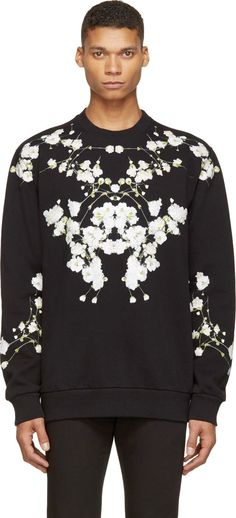 Colombian-fit sweatshirt in black. Ribbed crewneck collar, sleeve cuffs and hem. Floral print in white, green and yellow throughout. Fleecy interior. Tonal stitching.