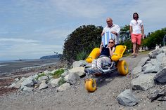 Jacquelyn Perry heads for the sands of White Rock beach with her dad, Vern, and program supporter Darren Marshall for the first time in about 15 years Wednesday. Melinda Edgson (below, left), Jacquelyn Perry and Vern Perry head for the shoreline.
