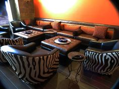 TLS by Design- Wall banquette, barrel chairs, with tufted ottomans.  #blendcigarbar #design