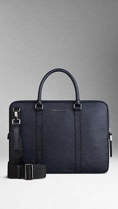 Burberry Navy London Leather Crossbody Briefcase - London leather briefcase with rolled leather handles and detachable webbed canvas crossbody strap.  Ziparound closure with oversize zip pulls, polished metal hardware.  Discover men's tailoring at Burberry.com