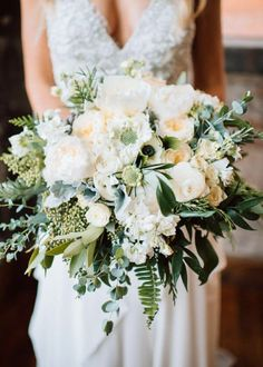 Lush Bride's Bouquet Showcasing: White Peonies, White English Garden Roses, White Ranunculus, White Anemones, White Stock, White Scabiosa, Green Sword Fern, Green Eucalyptus + Additional Greenery and Foliage