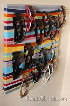 I LOVE THIS ONE AND IT'S TOO EASY TO WRAP RIBBON AROUND A CANVAS!!!! Sunglasses Holder $24.99 rayban sunglasses  http://www.okglassesvips.com