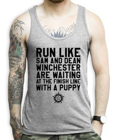 Run Like Sam And Dean Winchester Are Waiting At The Finish Line With A Puppy on an Athletic Grey Tank Top