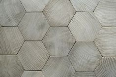 timber hexagons - I would love to use this in my living area....think it might cost a fortune though :/