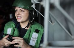Seaman Taylor Leverty, from St. Paul, Minn., communicates with the Military Sealift Command fast combat support ship USNS Arctic (T-AOE 8) during a replenishment-at-sea aboard the aircraft carrier USS Theodore Roosevelt (CVN 71)