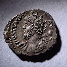 "An ancient Roman antoninianus minted under the rebel Emperor Postumus, in 281 AD. Postumus is shown in the guise of the hero Hercules, wearing the skin of the Nemean lion, draped over his left shoulder and carrying a club over his right. The inscription reading: ""Emperor Postumus Augustus"""