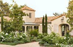 A profusion of white roses and lavender perfumes the landscape around Brooke and Steve Giannetti's Ojai, California, house.   - Veranda.com