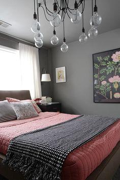 pink + black bedding + floral print + grey walls