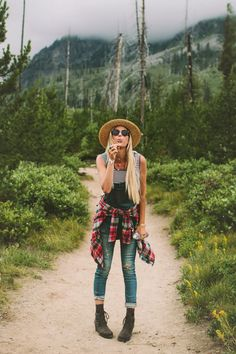 Hiking in Grand Teton National Park wearing overalls, stripes, plaid, and a straw hat