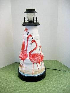 Cut Pot Lighthouse by Plaid Community. More Pot Lighthouse Ideas here:  http://www.completely-coastal.com/2013/04/make-clay-pot-lighthouse.html