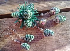 Polymer clay pine needles and cones (made into jewellery). Note: for inspiration only, this isn't a tutorial or for sale, as far as I can see.