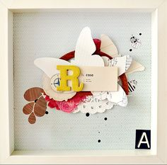 Create a shadow box by layering scrapbooking butterflies and flowers