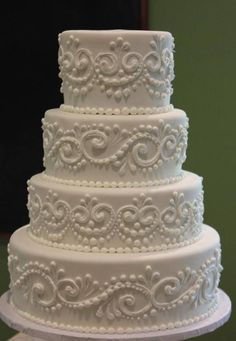 Image result for buttercream piped wedding cake with topper