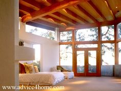white plaster walls and wood ceiling