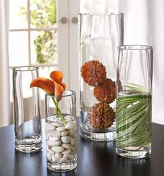 Simple, beautifully shaped glasses are decorative enough. Grouped together, they can hold various stones, plants or flowers submerged in water and form a zen corner of sorts.