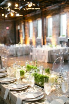 awesome urban vibe with neutral colors, grassy accents, modern decor, ghost chairs, rafter lighting