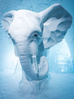 Custom suites at the 26th Icehotel in the Arctic Circle include a life-sized ice elephant