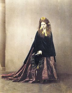 "Vengeance (1863-1867)  When her husband, Count de Castiglione, threatened to take their son out of her care, the Countess sent him this hand-coloured photograph, which shows her grasping a dagger in her right hand. Matching the murderous look on her face, the portrait is entitled ""Vengeance"" and dedicated ""Au comte de Castiglione/Reine d'Etrurie"" (to the Count de Castiglione/ the Queen of Etruria).  The Count did not proceed with his plan."