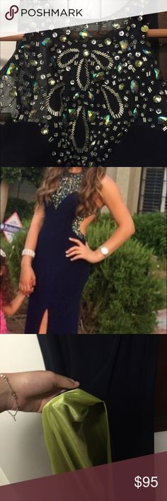 Long elegant navy blue dress Worn once for a pageant. Size 0 but it's stretchy. Neon green inside the slit goes perfect with the navy blue. Perfect for homecoming/prom or any other dance Dresses