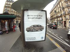 """Climate Change poster in Paris 2015  'We're only sorry we got caught'  a reference to Volkswagen""""s carbon emissions scandal"""