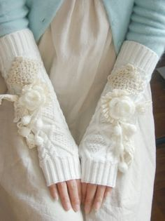 crochet flowers and mini squares, lace and pompoms adorn these beautiful, knit arm warmers all in white.  Very pretty, indeed!