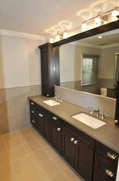 Hallway Bathroom with Double Vanity with Double Towers, and Inset Mirror.