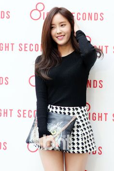 Hyomin T-ara. I love her simple long sleeved black shirt paired with the black and white houndstooth skirt. Along with the silver clutch.