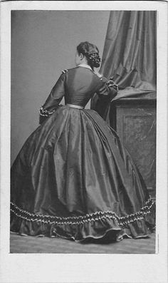 I will never understand why women would have wasted the money on a photo of the back of their head! But she does have gorgeous hair! And look how the back of her skirt is kicked out funny. - Visit to grab an amazing super hero shirt now on sale! Historical Costume, Historical Clothing, Victorian Fashion, Vintage Fashion, Victorian Era, Victorian Ladies, Civil War Fashion, Civil War Dress, 19th Century Fashion