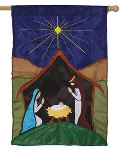 Celebrate the birth of Jesus Christ with this beautifully sewn nativity scene themed applique house flag. The artwork consists of an abstract, yet colorful depiction of Jesus, Mary and Joseph inside t