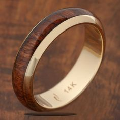 14K Yellow Gold Natural Hawaiian Koa Wood Inlaid Wedding Ring 5mm Item Number: GKR6002 Material: 14K Yellow Gold and Koa Wood Band Width: 5mm Weight: approximately from 3 gram to 5 gram depend on the