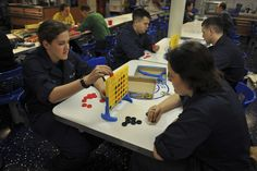 PACIFIC OCEAN (May 3, 2014) Sailors play board games set out by the Coalition of Sailors Against Destructive Decisions aboard the aircraft carrier USS Nimitz (CVN 68). Nimitz is currently underway conducting flight deck certifications. (U.S. Navy photo by Mass Communication Specialist 3rd Class Eric M. Butler/Released)