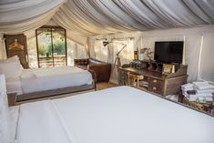 Our Travel Tuesday comes from us enjoying coffee under a safari tent canvas ☕️ Now, this is what we call glamping!  #TravelTuesday #glamping #safaritent #LuxuryTravel