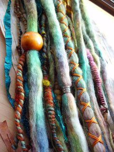 Removable Wool Tie-dye dreads by Purple Finch! Set of 10 total Hair Extensions  Set Includes: 7 wool tie-dyed dreadlocks 1 wool tie-dyed x-cross wrapped dreadlock 2 multi-material extensions